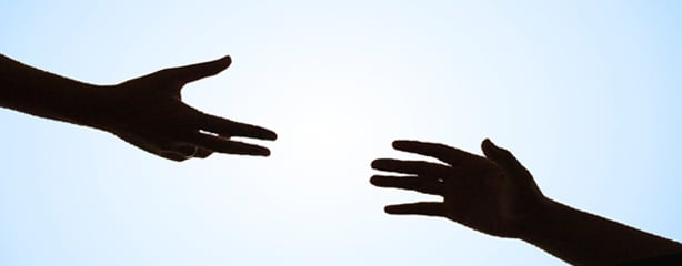Silhouette of Helping Hands