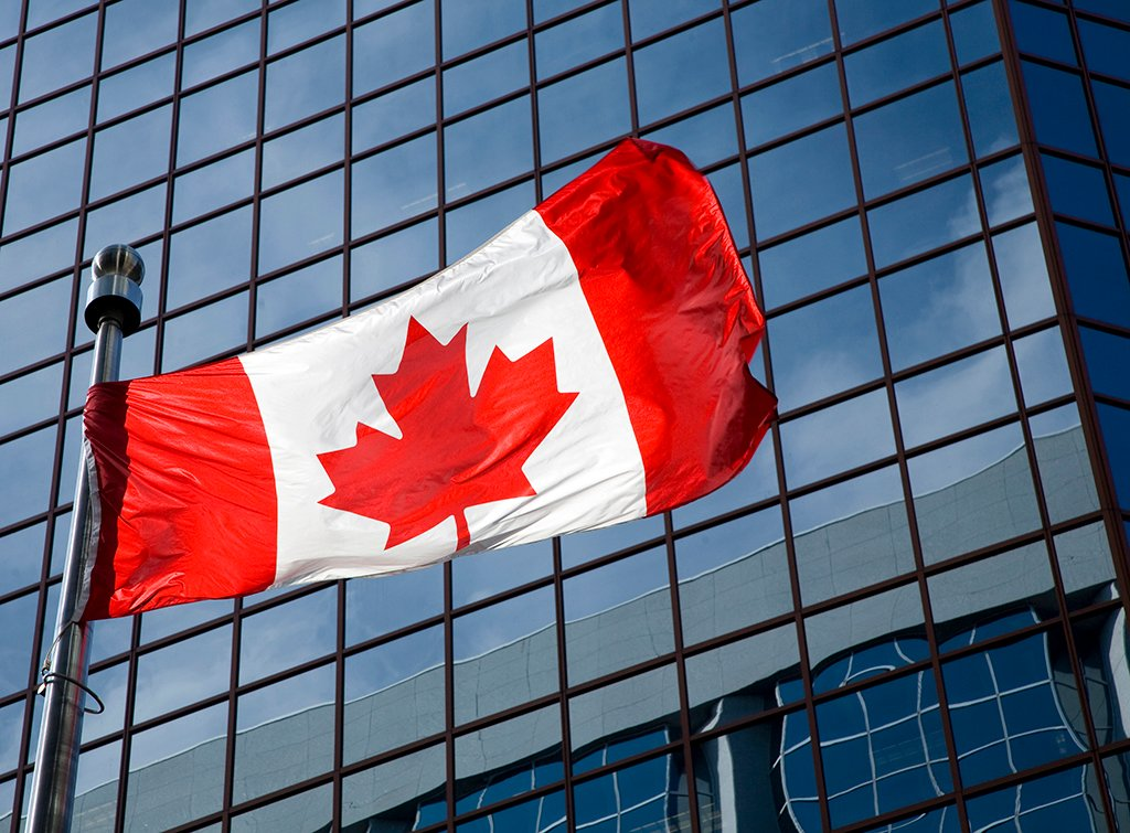 iStock_000006975570_Large Canada Canadian Flag Country International Building Reflective