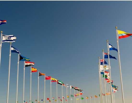 world-flags-on-display-bellow-the-blue-sky-picture-id186858651