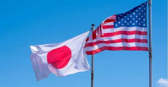 american-and-japanese-flags-waving-against-blue-sky-picture-id957819534
