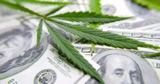 cannabis-leaf-on-dollar-bill-green-leaf-of-marijuana-money-and-hemp-picture-id1143359897