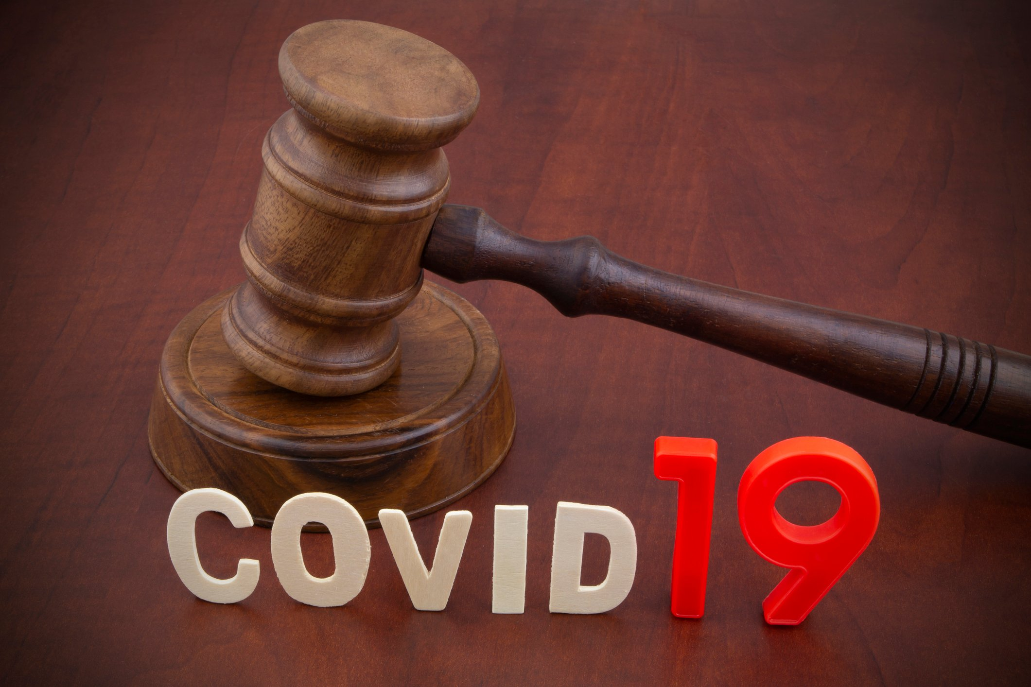 Judge's gavel with letters covid19. Concept of quarantine and law against covid-19.
