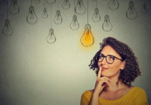 https-globaliptechblog-squirepattonboggsblogs-com-wp-content-uploads-sites-17-2020-03-woman-in-glasses-looking-up-with-light-idea-bulb-300x210-jpg