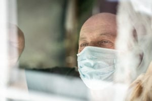 https-globaliptechblog-squirepattonboggsblogs-com-wp-content-uploads-sites-17-2020-04-senior-man-with-mask-looking-trough-window_gettyimages-1212302592-300x200-jpg