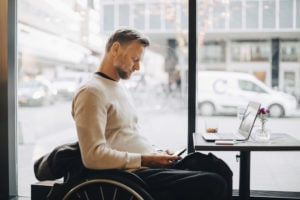 https-employmentlawinsightsfullservice-babc-blogs-com-wp-content-uploads-sites-36-2021-04-man-in-wheelchair-on-laptop-in-coffee-shop_gettyimages-1140447724-300x200-jpg