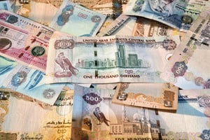 United Arab Emirates Currency notes spread on table